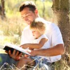 Father-and-daughter-reading-Bible-in-the-park-2