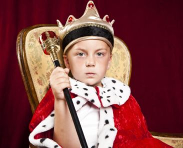 little-boy-dressed-ad-a-king-on-red-velvet-background