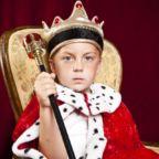 little-boy-dressed-ad-a-king-on-red-velvet-background